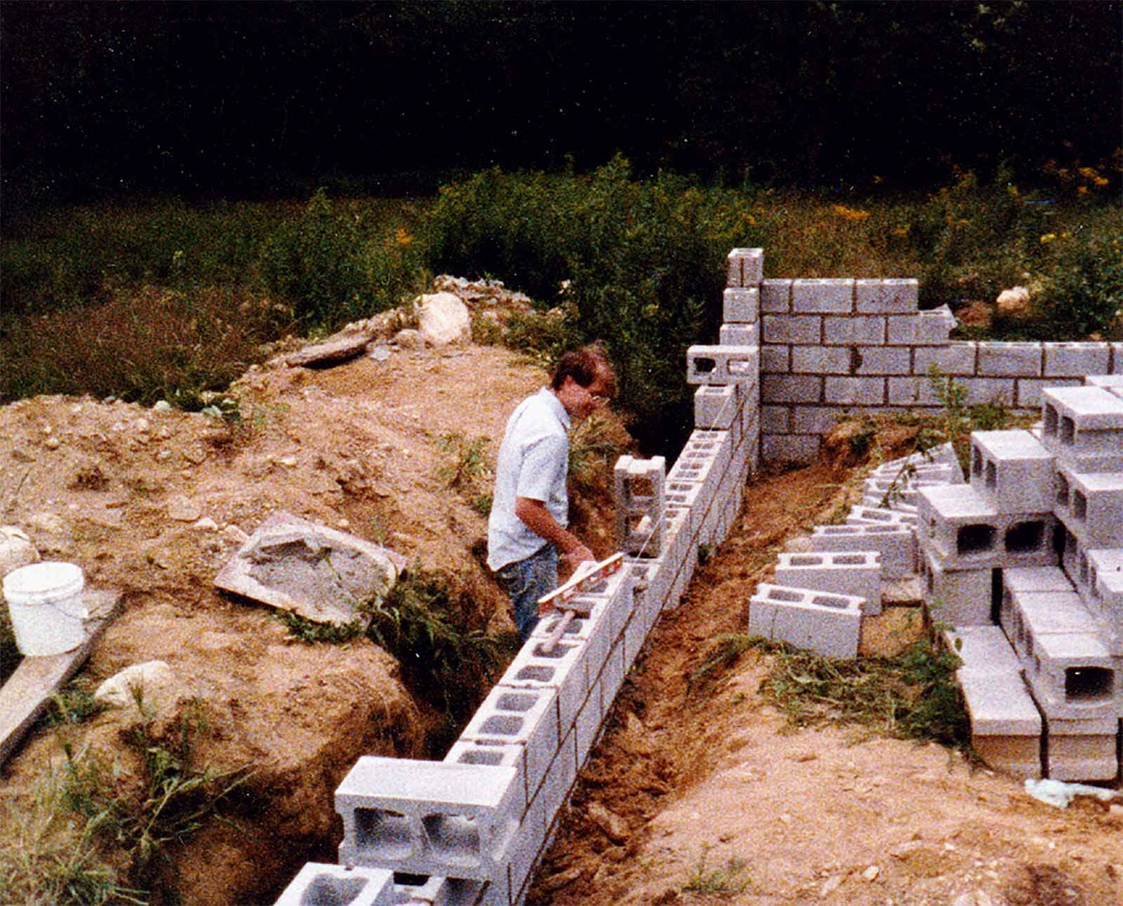 Andrew DeVries laying the foundation for River Studio building 1986