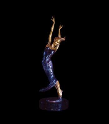 Allegro a half life size female figurative bronze dancer by sculptor Andrew DeVries
