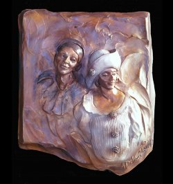 Amore a bronze romantic wall relief sculpture by sculptor Andrew DeVries