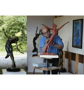 Sculptor Andrew DeVries creating an original clay model of Destiny