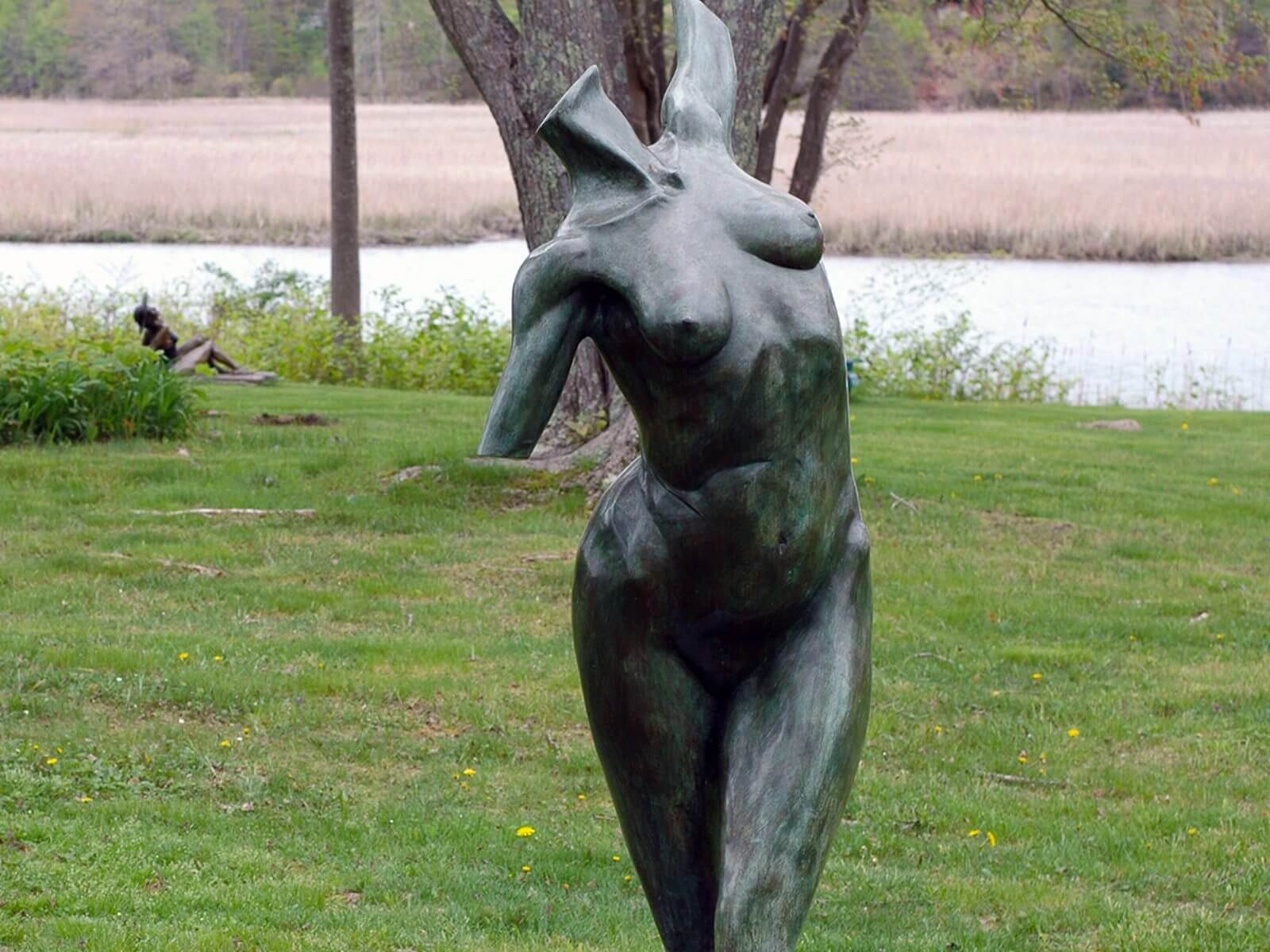 Calliope an over life size female bronze figurative torso sculpture commissioned by Harold and Julie de Wolff installed at Miss Porter's School in Farmington CT by Andrew DeVries