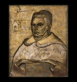 Father Mullooly bas relief portrait sculpture installed in St. Marks Church Lanesborough Ireland by Andrew DeVries