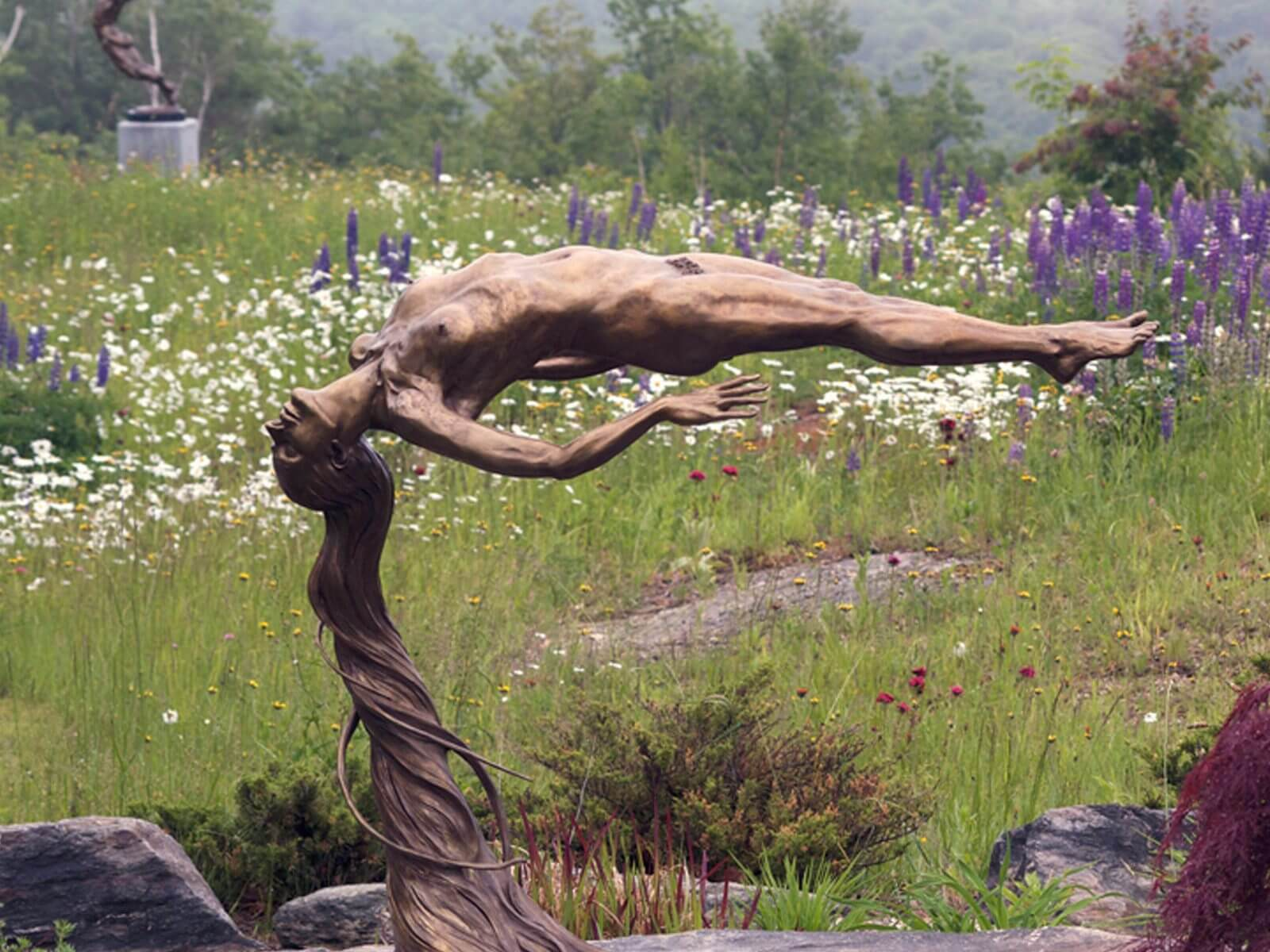 Innocence a bronze female nude outdoor garden sculpture by figurative sculptor artist Andrew DeVries