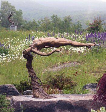 Innocence a bronze female nude outdoor garden sculpture by figurative sculptor artist Andrew DeVries