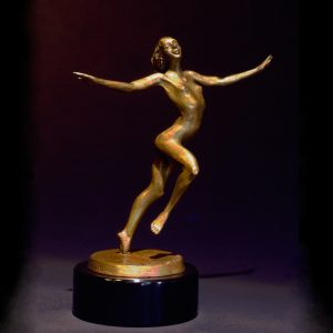 Le Jardin a medium size female nude bronze figurative dancer by sculptor Andrew DeVries