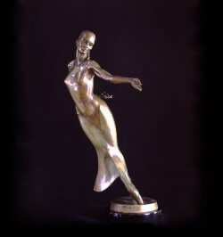 Nocturne a half life size female figurative bronze dancer by sculptor Andrew DeVries