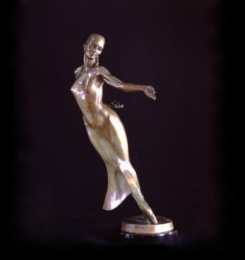 Nocturne a half life size female figurative bronze dancer by sculptor Andrew DeVries