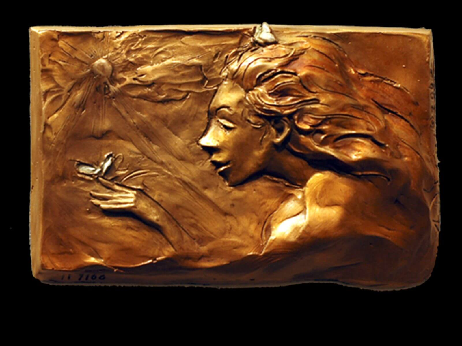 Papillion a bronze figurative relief wall sculpture by Andrew DeVries