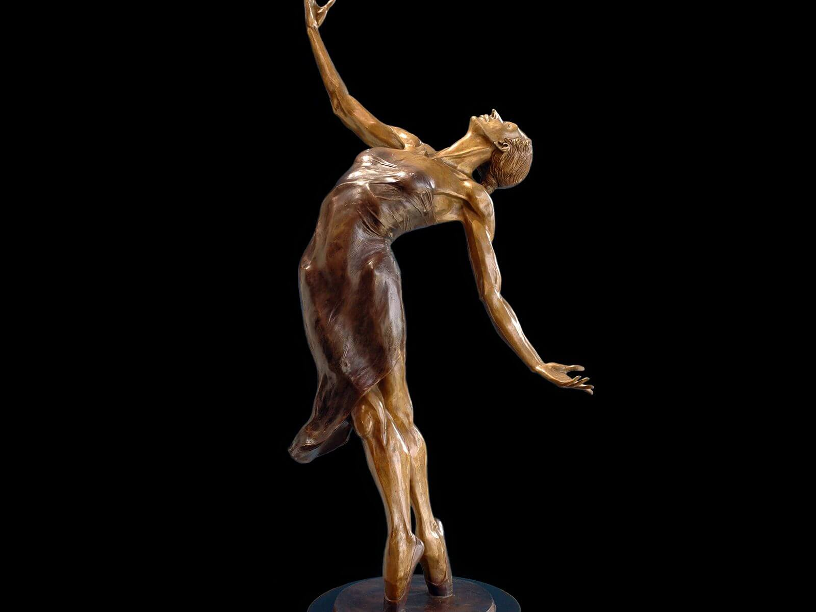 Pleiades a half life size female figurative bronze ballet dancer by sculptor Andrew DeVries