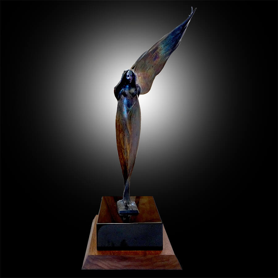 Shaker Angel is a bronze sculpture by Andrew DeVries . Created and cast by the artist at his studios in Middlefield, MA Copyright 2004