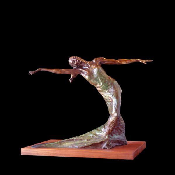 Terpsichore a large fremale bronze dancer by sculptor Andrew DeVries