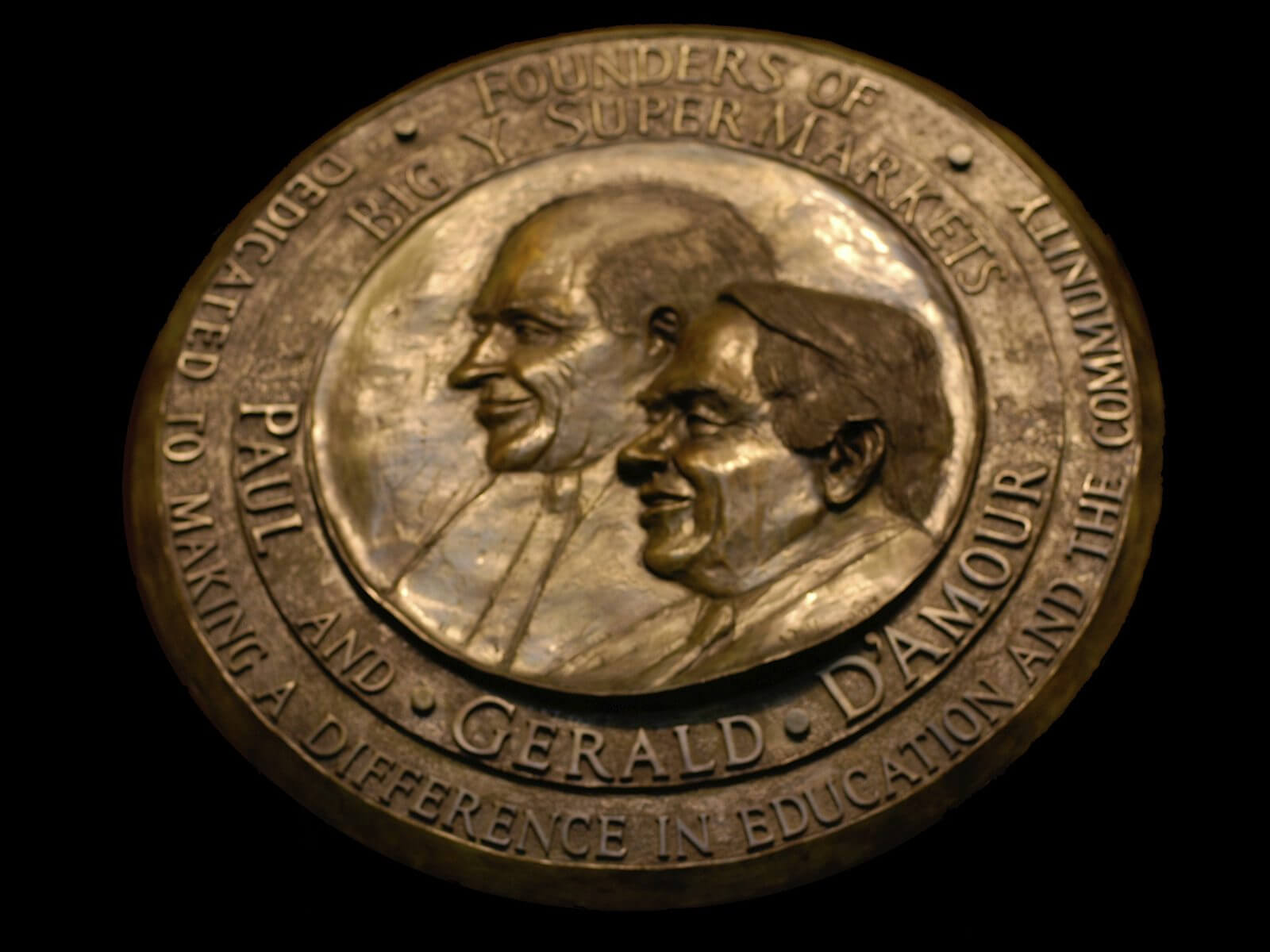 Paul and Gerald D'Amour relief portrait in bronze by Andrew DeVries installed in the Western New Englad College Library