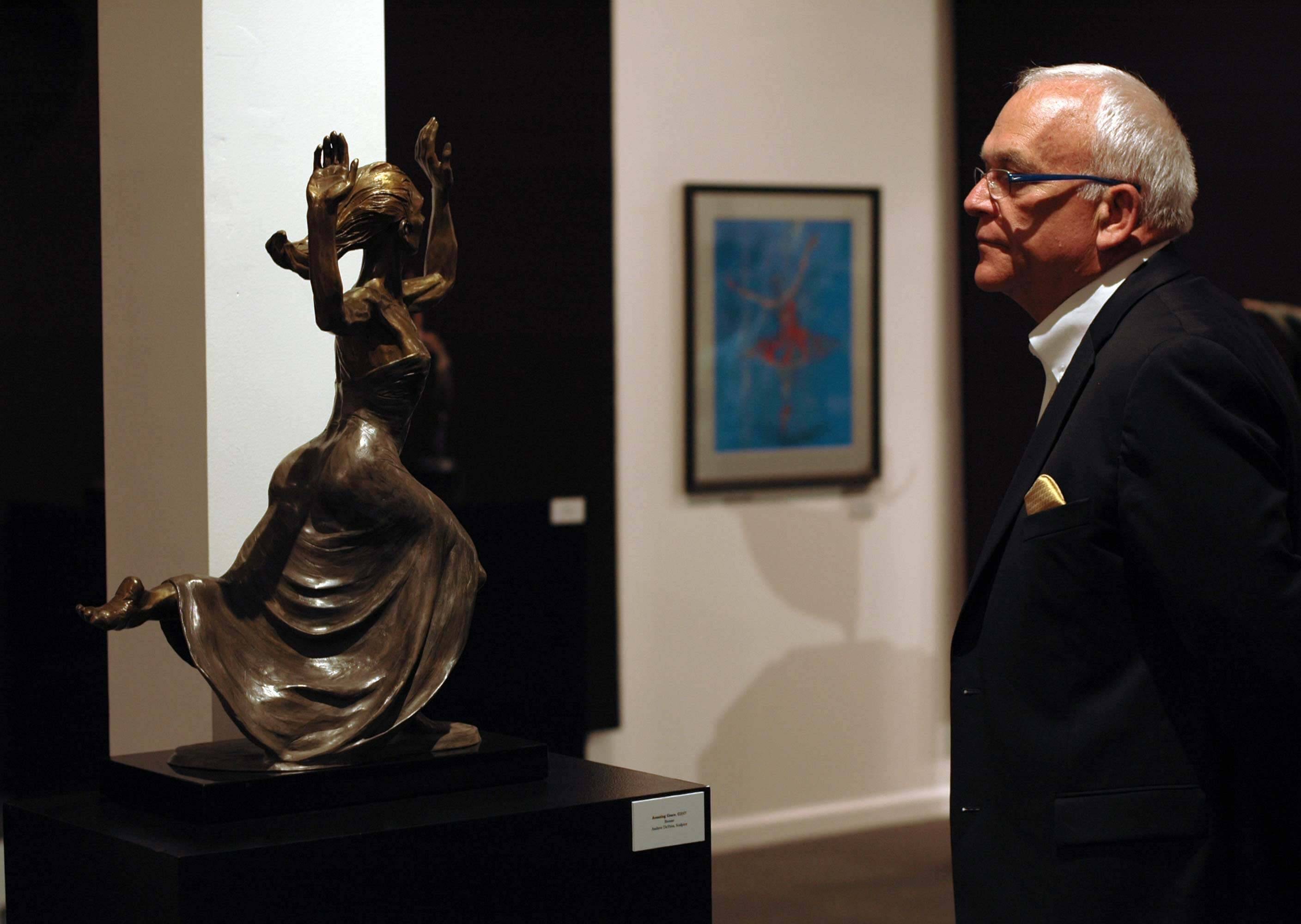 Museum visitor viewing a bronze dace sculpture by Andrew DeVries at the national Museum of Dance