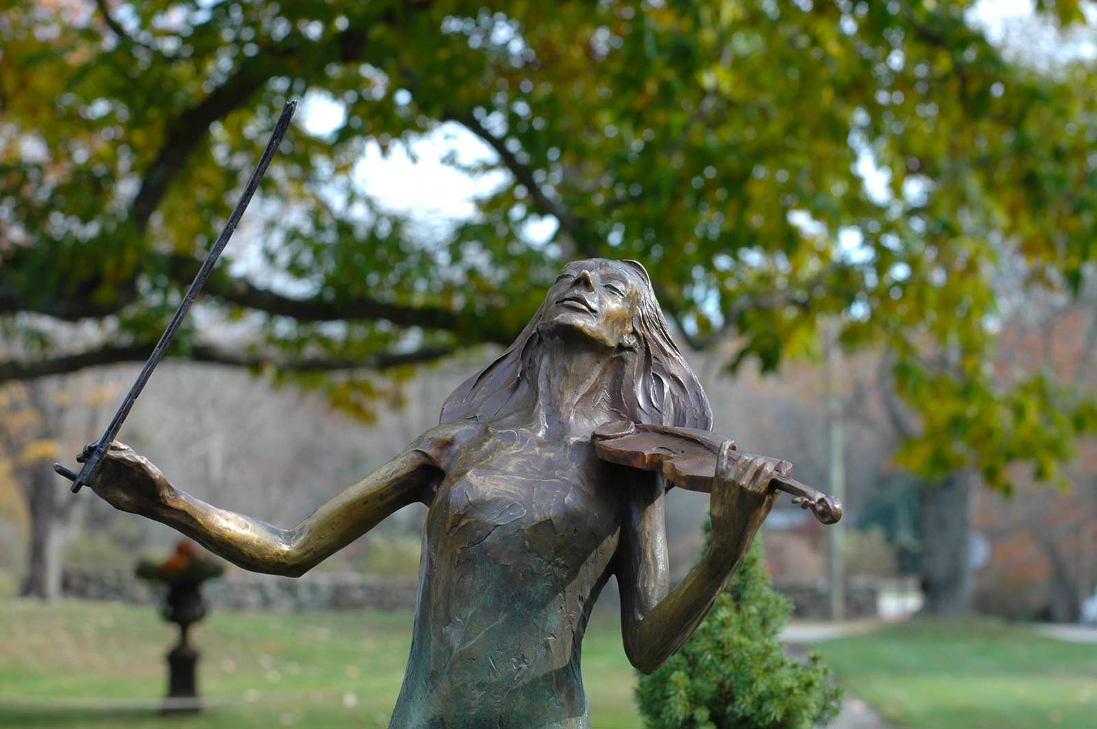 Rapture bronze violinist sculpture by Andrew DeVries