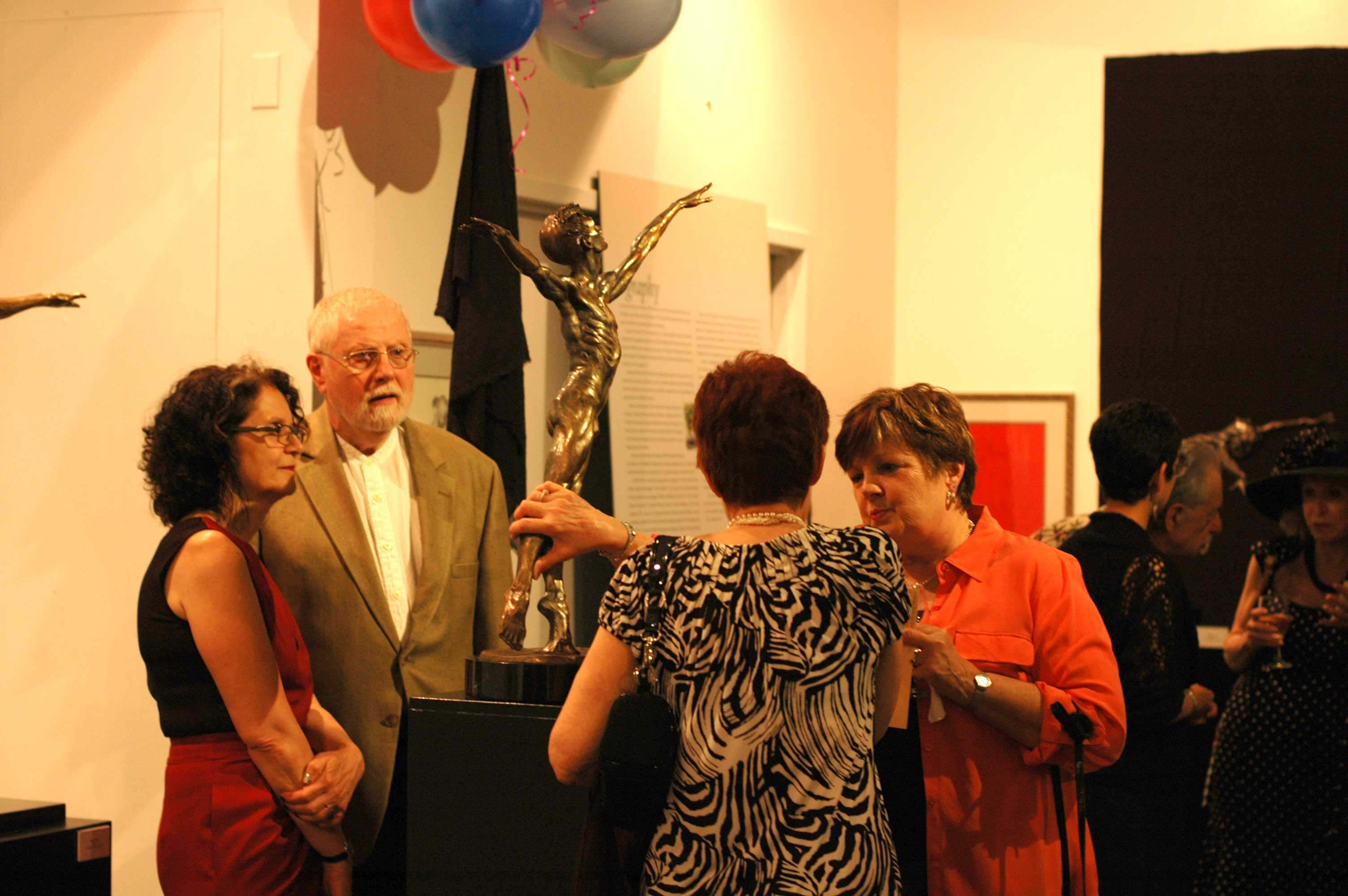 Museum visitors viewing a bronze dance sculpture by Andrew DeVries at the National Museum of Dance during the Opening Reception of Homage to Dance