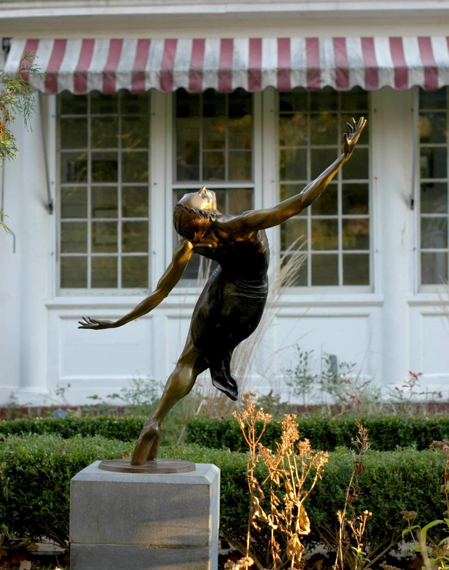 Pleiades a large bronze dance sculpture by Andrew DeVries
