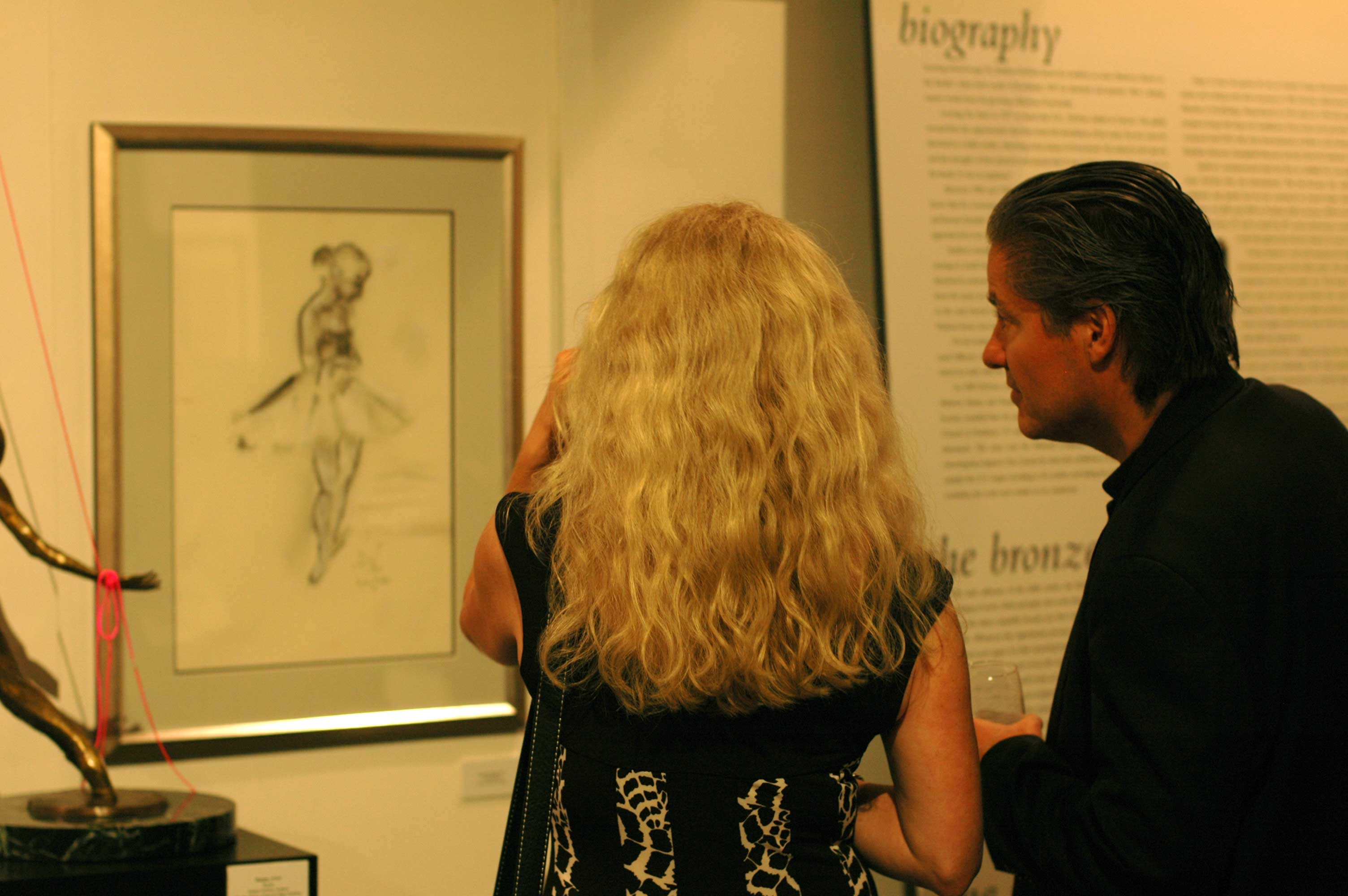 Museum visitors viewing a dance drawing by Andrew DeVries at the National Museum of Dance during the Opening Reception of Homage to Dance