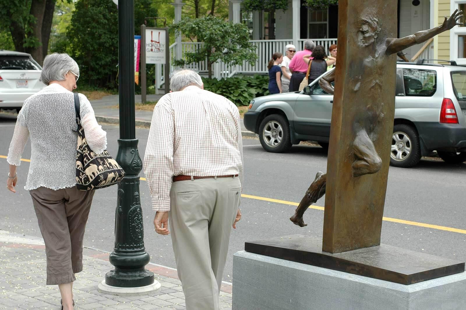 Other Side of Eden bronze sculpture by Andrew DeVries Lenox Sculpture Walk