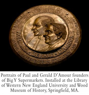 A bronze relief portrait of Paul and Gerald D'Amour by Andrew DeVries installed in the Western New England College Library and Wood Museum in Springfield