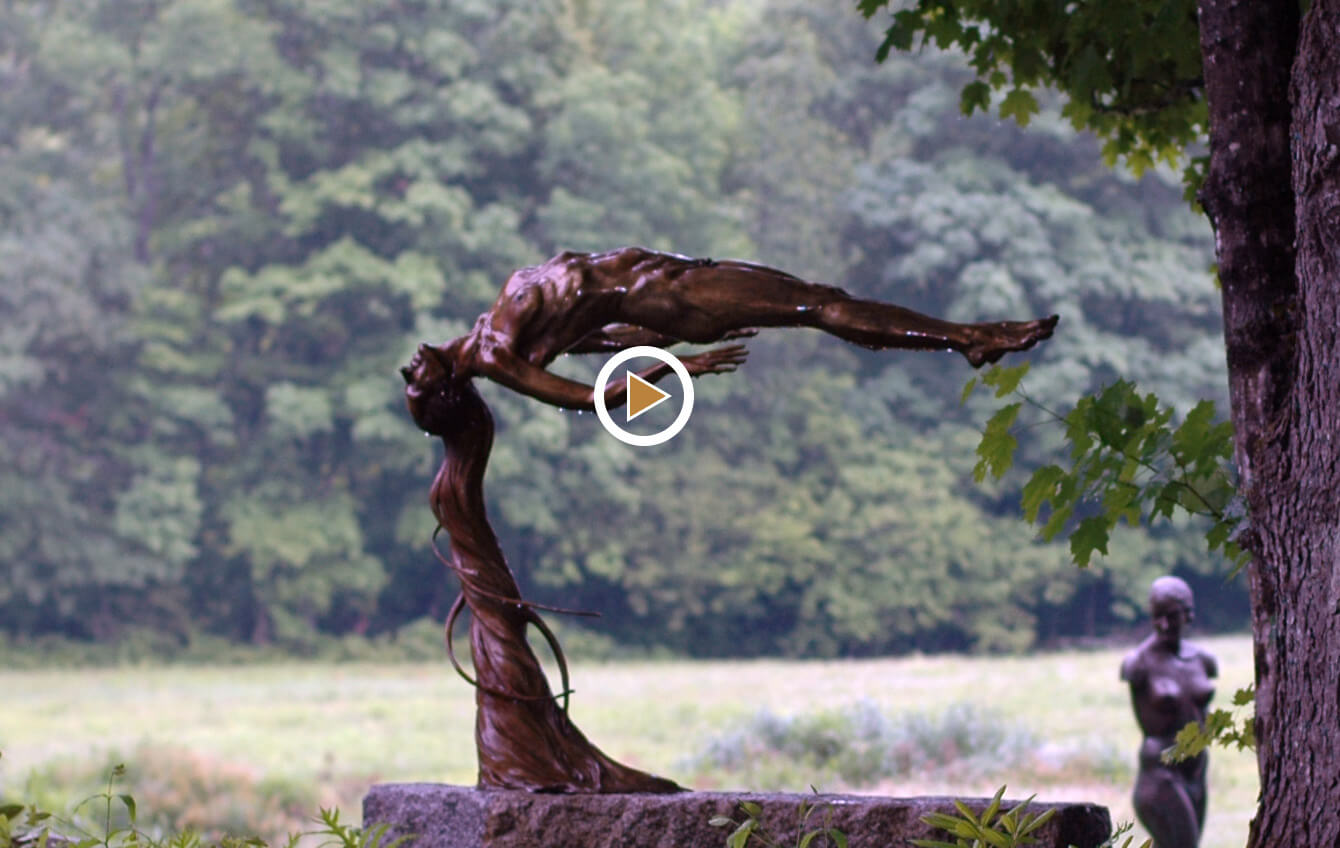 Innocence a floating bronze female nude figurative sculpture by Andrew DeVries copyright 2009