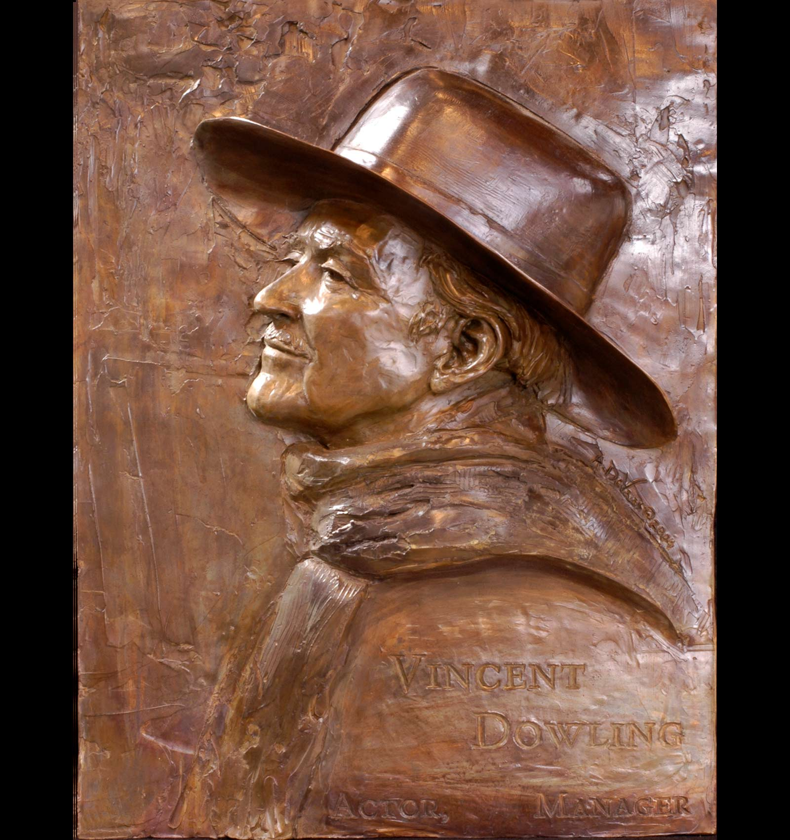 Oortrait of Vincent Dowling a Bronze figurative sculpture relief portrait of the actor and director Vincent Dowling by Sculptor Andrew DeVries installed at the Abby Theatre in Dublin