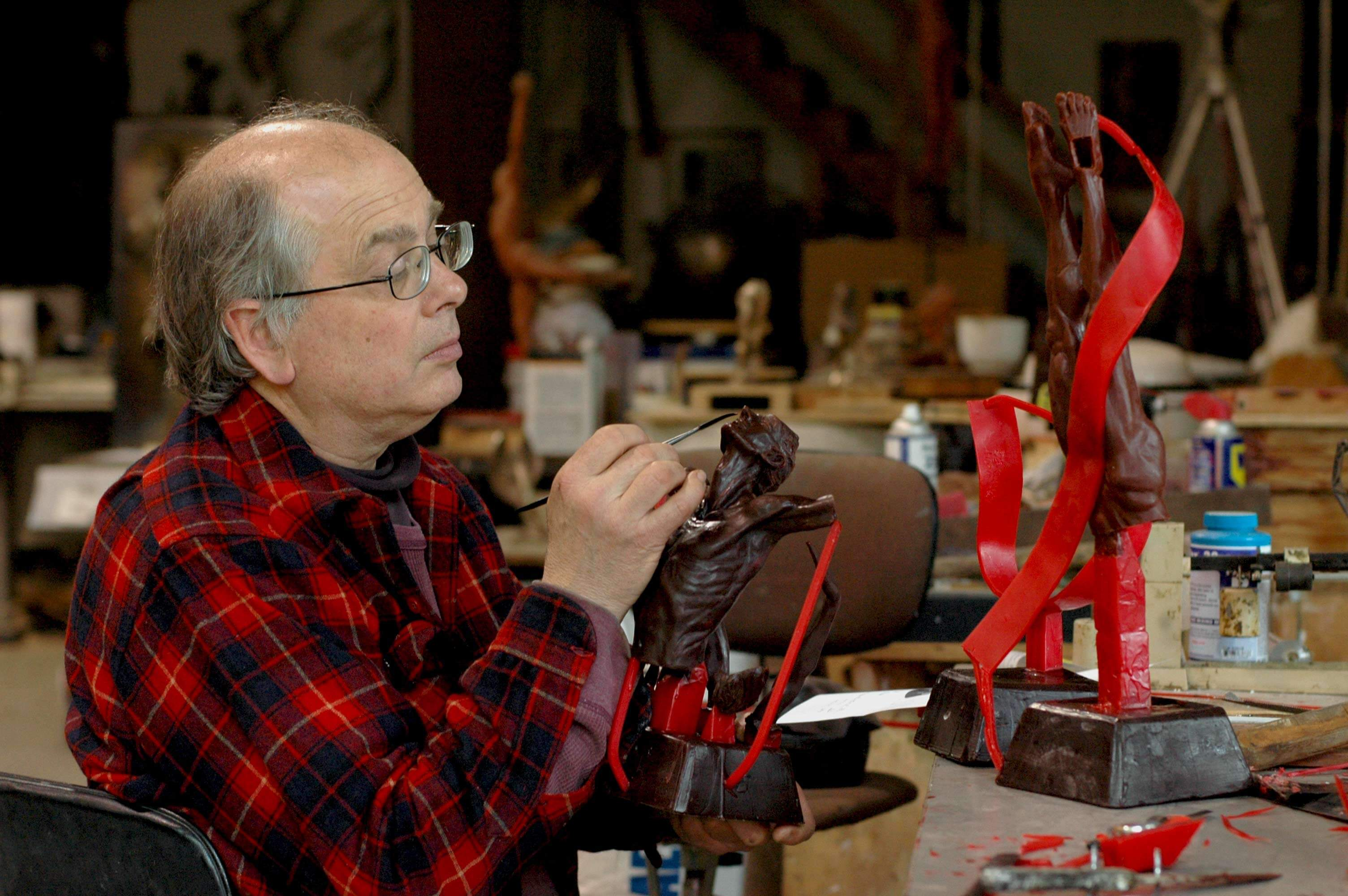 Sculptor Andrew deVries works on the maquette for the Echoes commission