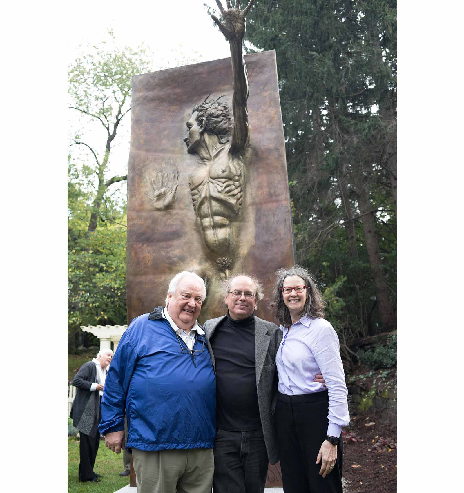 Tom and mary Steffef Blaske with sculptor Andrew DeVries at the unveiling of the Other Side of Eden at their home in Ann Arbor, MI