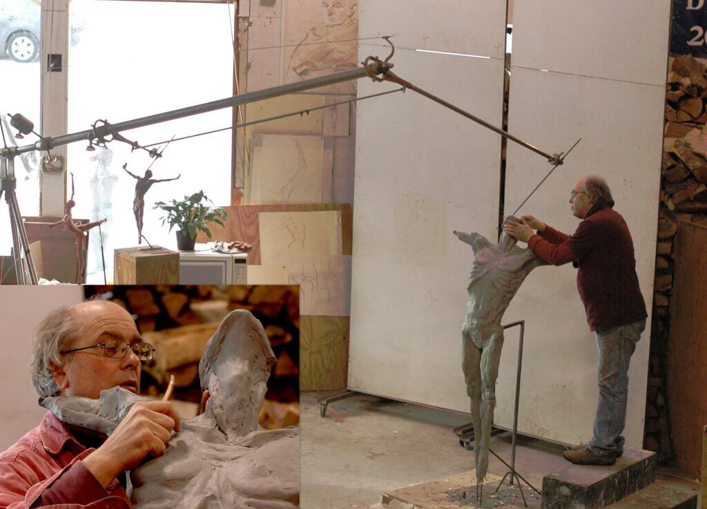 Sculptor Andrew DeVries working on the clay enlargement of Echoes three quarter life size.