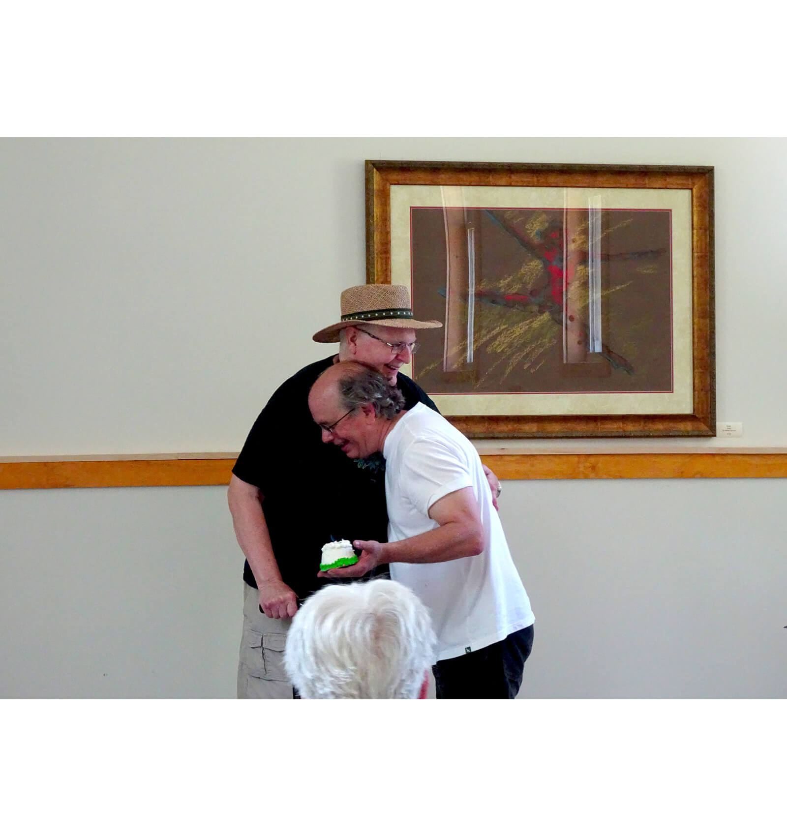 Andrew hugs John Jesse after John gives him a birthday cake!
