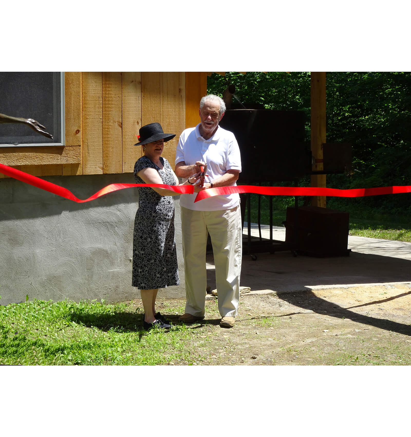 Patricia Purdy and Harold Rudin cut the ribbon