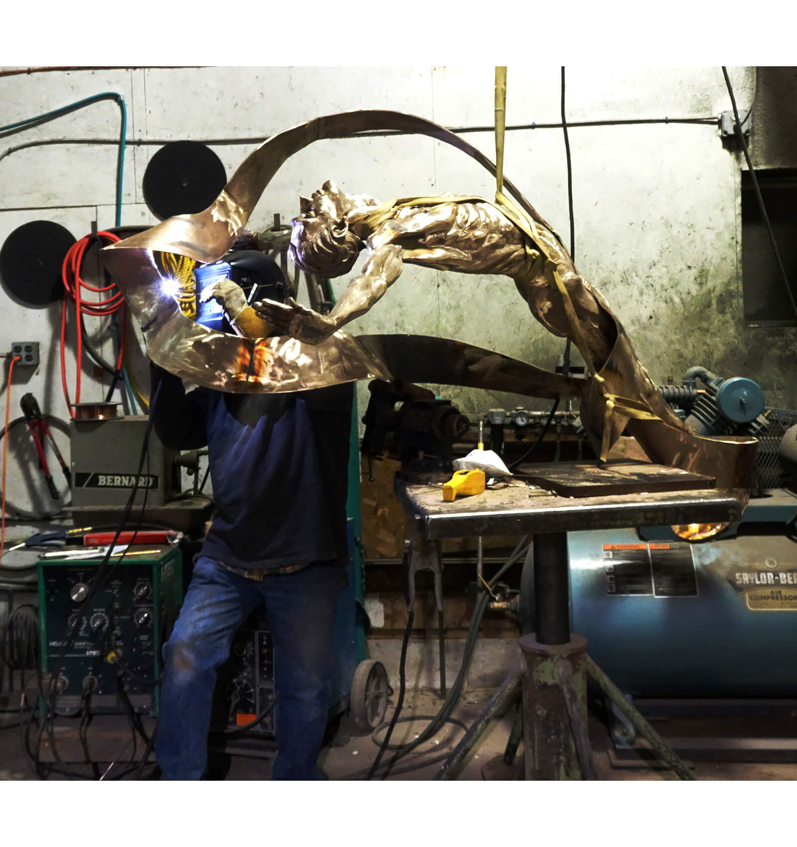 Andrew DeVries welding the final section of the Mobius strip on