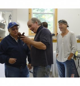 Sculptor Andrew DeVries explains wax chasing to visitors in the casting studio.